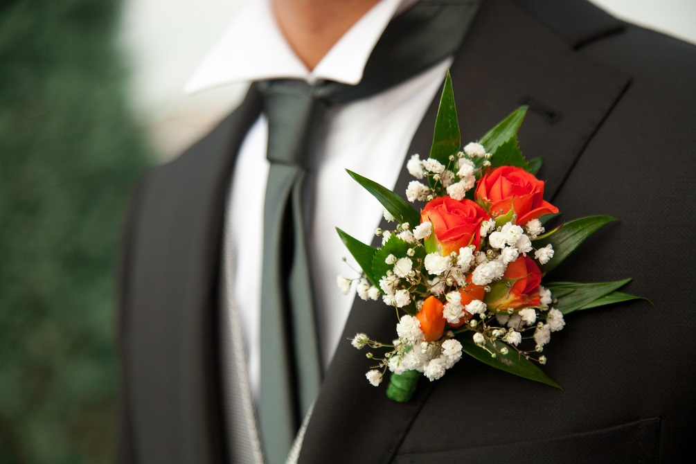 Bridegroom with a white flower decoration